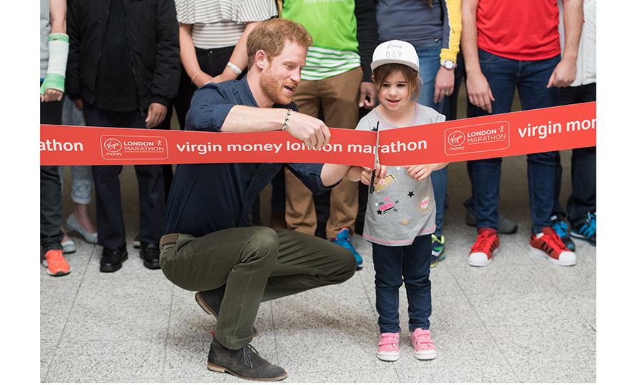 Dashing Prince Harry gave a little girl a hand with cutting the ribbon for the 2017 Virgin Money London Marathon Expo on April 19 in London. 