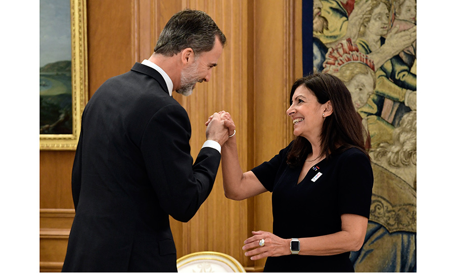 We're used to seeing curtsies, but here the royal tables were turned as King Felipe VI of Spain kissed the hand of the mayor of Paris, Anne Hidalgo, during their meeting at La Zarzuela Palace in Madrid on April 19.