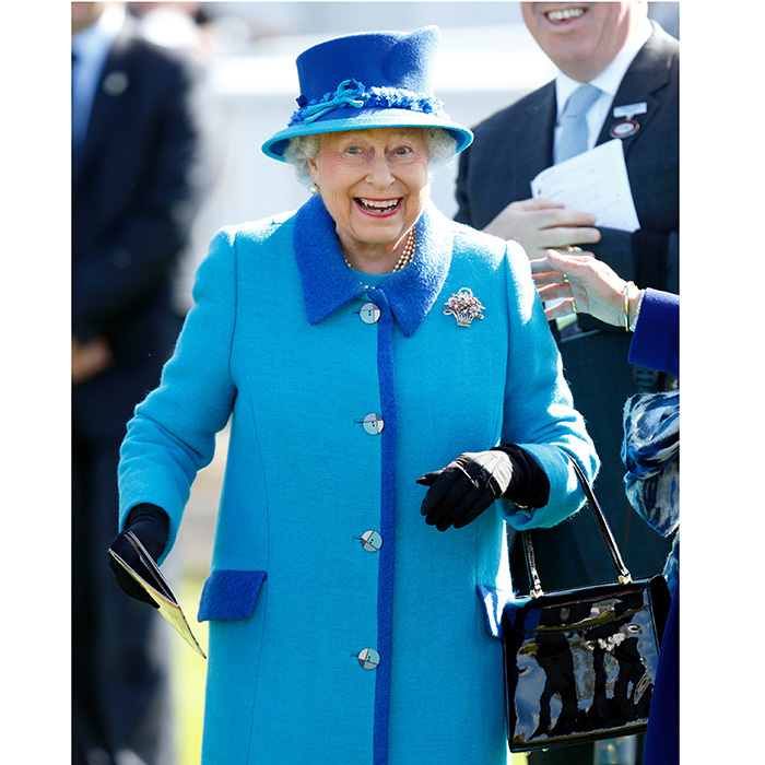 One is very amused! Queen Elizabeth II couldn't contain her excitement as she watched her horse Call To Mind win The Dubai Duty Free Tennis Championships Maiden Stakes at Newbury Racecourse on April 22 in England.