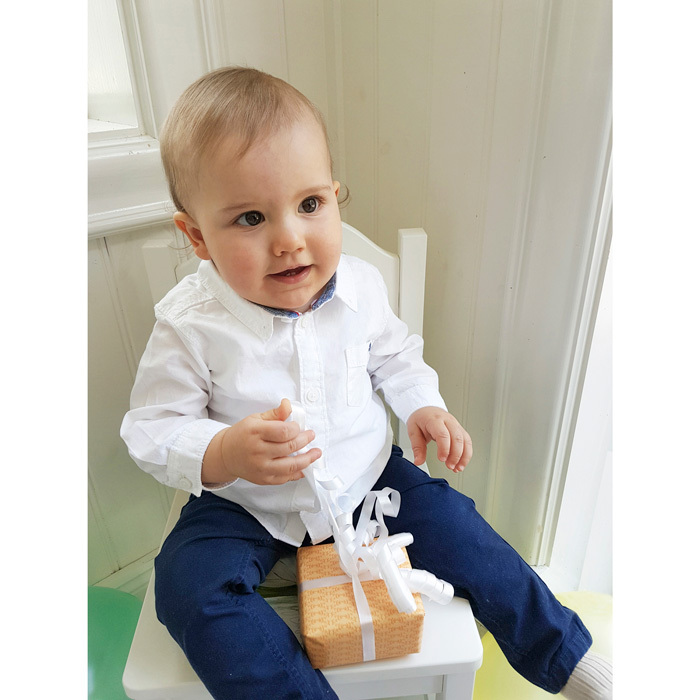 Prince Carl Philip snapped this more casual photo of his son to mark his milestone birthday. Alexander held on tight to his present and sat in his chair.