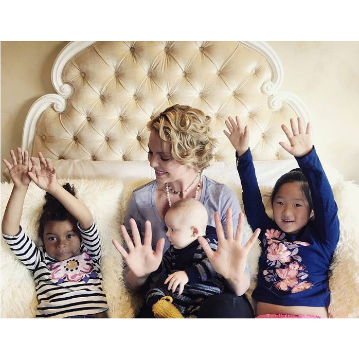 The <i>Unforgettable</i> star and her three kids raised their hands to fight hunger with proceeds for the number of likes or shares the photo received going to Feeding America.