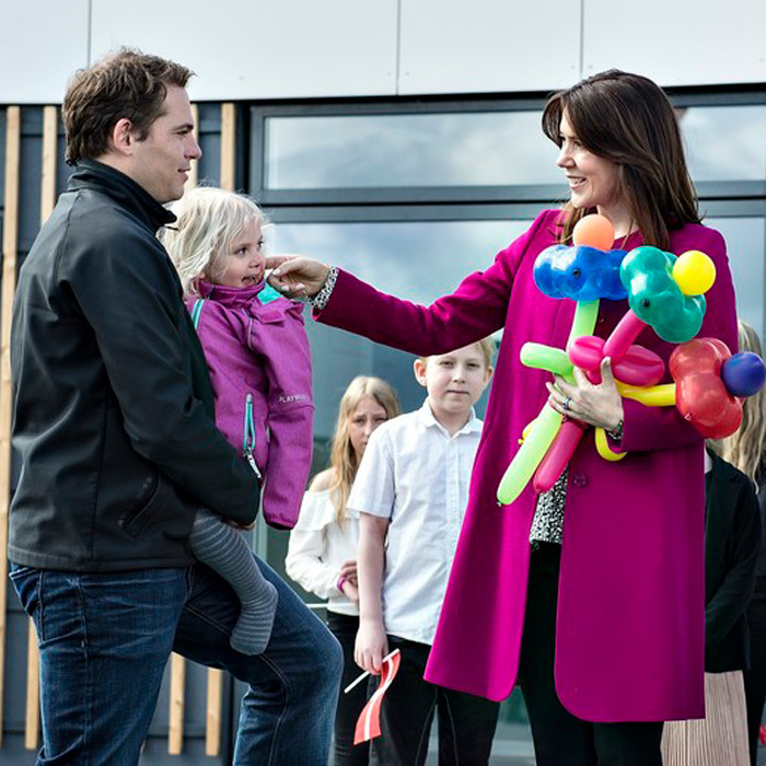 Crown Princess Mary of Denmark, with balloons in tow, met with families and children at TrygFondens Family House.