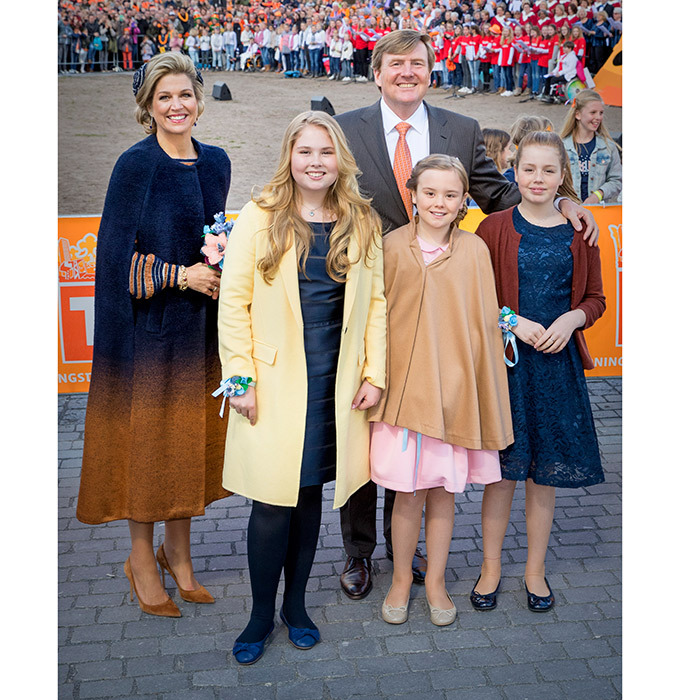 April 27: Queen Maxima and her daughters Princess Amalia, Princess Alexia and Princess Ariane looked like the perfect family match in their cozy earth tones at King Willem-Alexander's 50th birthday celebration in Tilburg, Netherlands. The King fit right in too, in his orange-hued tie.