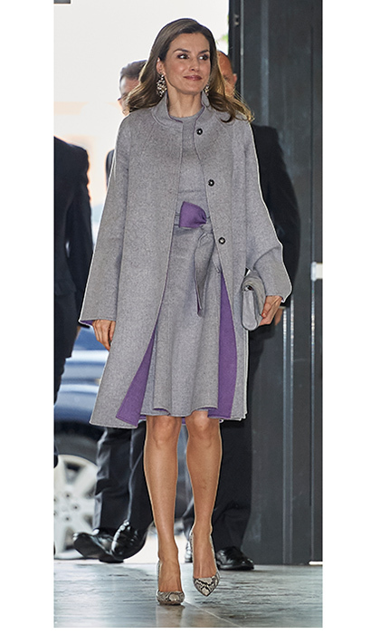 April 27: Queen Letizia layered up in a grey ensemble with hints of regal purple for an unseasonally chilly day at Cardenal Herrera University in Valencia, Spain.
