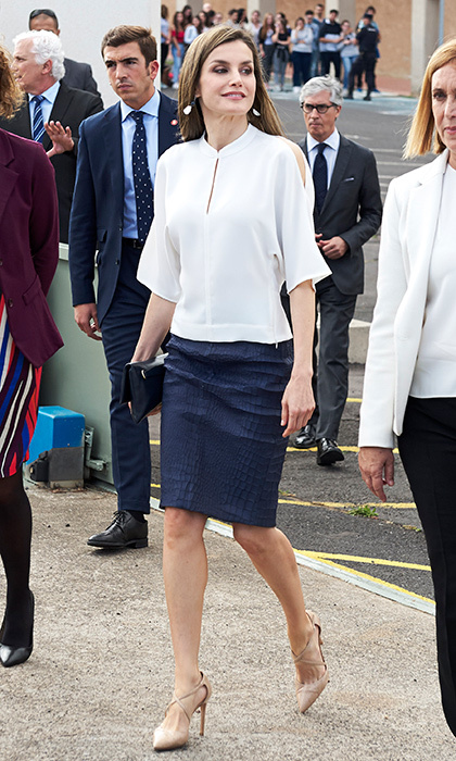 April 25: Queen Letizia of Spain wore one of her favorite styles – a leather pencil skirt – and blouse with peek-a-boo shoulders for a visit to La Laguna University on the Spanish island of Tenerife.