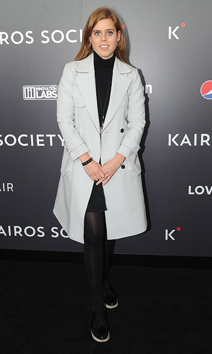 April 24: Princess Beatrice of York stepped out in a turtleneck and spring trench for the Kairos Society Global Summit At One World Observatory in New York City.