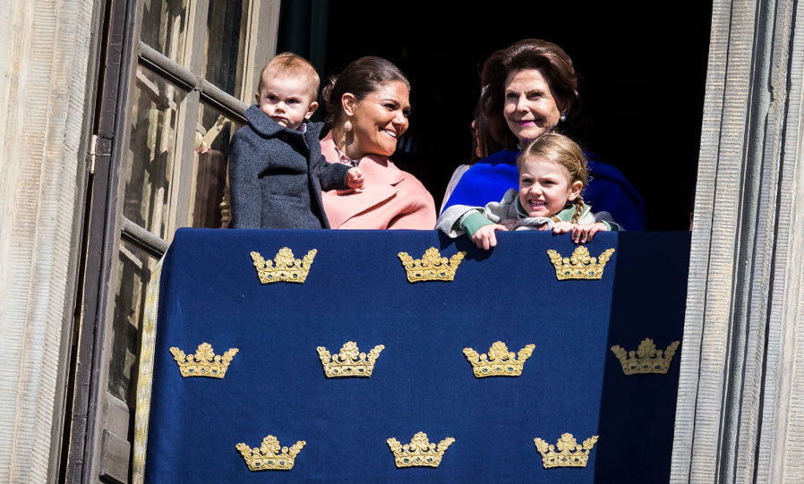 The Swedish royals took to the palace balcony to look on at King Carl Gustaf's 71st birthday celebration. Crown Princess Victoria held on to Prince Oscar as her mom Queen Silvia lifted Princess Estelle, who had her signature big grin.