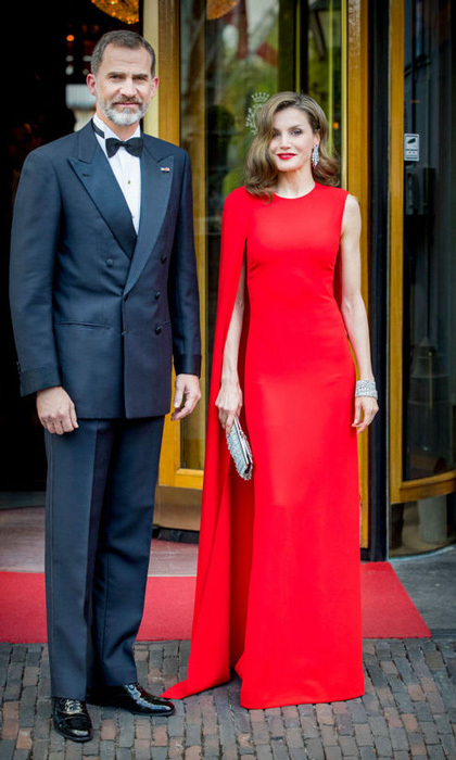 April 29: Queen Letizia and King Felipe VI traveled from Madrid to The Hague for King Willem-Alexander's private birthday dinner. The Spanish Queen had a style moment in a red Stella McCartney-caped gown.