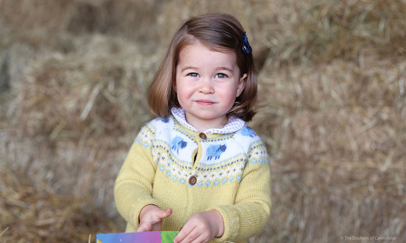 On May 1, 2017, Kensington Palace released a new photo of Charlotte ahead of her second birthday. The picture was shot outside of their Norfolk home Anmer Hall by mom Kate Middleton in April.