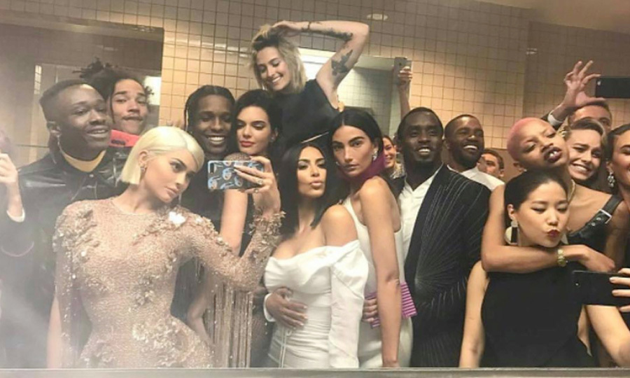 "#SelfieGoals! Kylie Jenner, Kim Kardashian, Paris Jackson and a number of famous faces came together for an epic bathroom selfie at the Met Museum. Oscar winner Brie Larson shared the restroom snap writing, ""I needed to go the bathroom and ended up famous.""