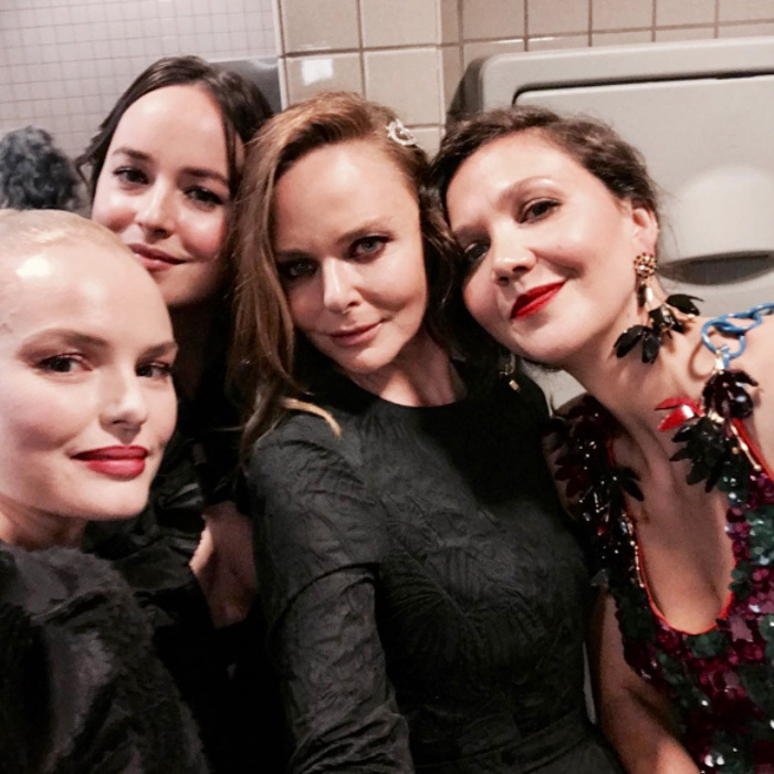 "The girls' room! Kate Bosworth, Dakota Johnson, Stella McCartney and Maggie Gyllenhaal convened in the bathroom during the gala. Stella simply captioned the photo, ""All goes down in the toilets.""