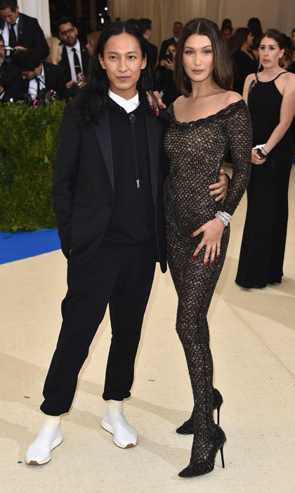 "Bella Hadid turned heads wearing a bodysuit by Alexander Wang. The designer told reporters, ""She's the body of our generation,"" adding, ""What better to show off a body than a catsuit.""