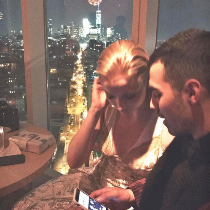 "Sophie Turner cozied up next to her boyfriend Joe Jonas at a the Top of the Standard. Nick Jonas shared a photo of the lovebirds, writing, ""These two ❤️.""