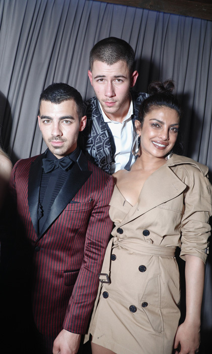 Priyanka Chopra slipped into a shorter version of her Ralph Lauren gown for a night on the town with Nick and Joe Jonas. The trio were spotted at Rihanna's after-party at 1 OAK where guests snacked on food provided by Black Tap and Jue Lan.