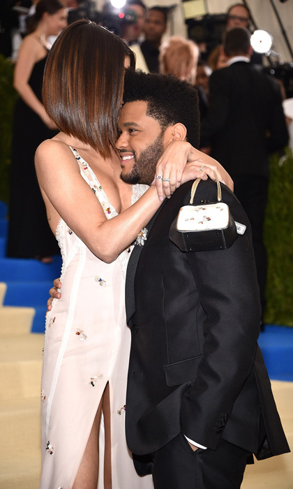 Selena Gomez couldn't keep her hands to herself while on the carpet with her musician beau, The Weeknd.