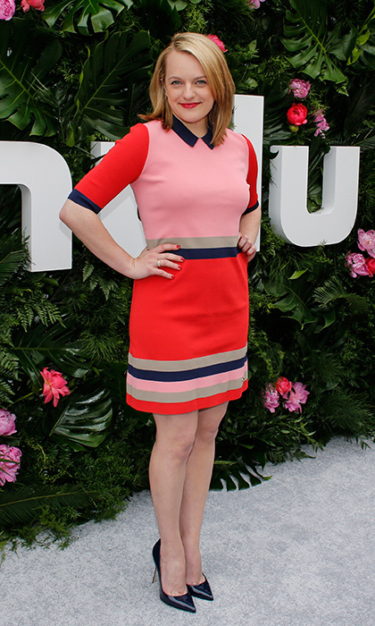 Former <I>Mad Men</I> actress Elizabeth Moss, now starring in <I>The Handmaid's Tale</I>, went back to her retro roots with this striped Ted Baker minidress for the Hulu Upfront Brunch at La Sirena Ristorante in New York City. 