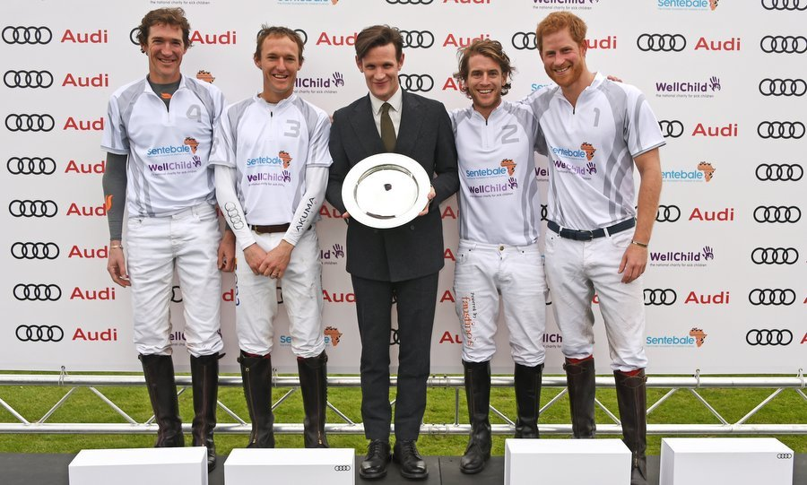 Prince Harry, right, couldn't have looked happier on May 6 as actor Matt Smith, center, presented his team with a prize on Day One of the Audi Polo Challenge in Ascot, England. That might have been because his actress girlfriend Meghan Markle, who was spotted on the sidelines at the match, was there to cheer him on for the first time. With the <I>Suits</I> star set to join Prince Harry at Pippa Middleton's wedding on May 20, the event marked their first public appearance together as a couple.