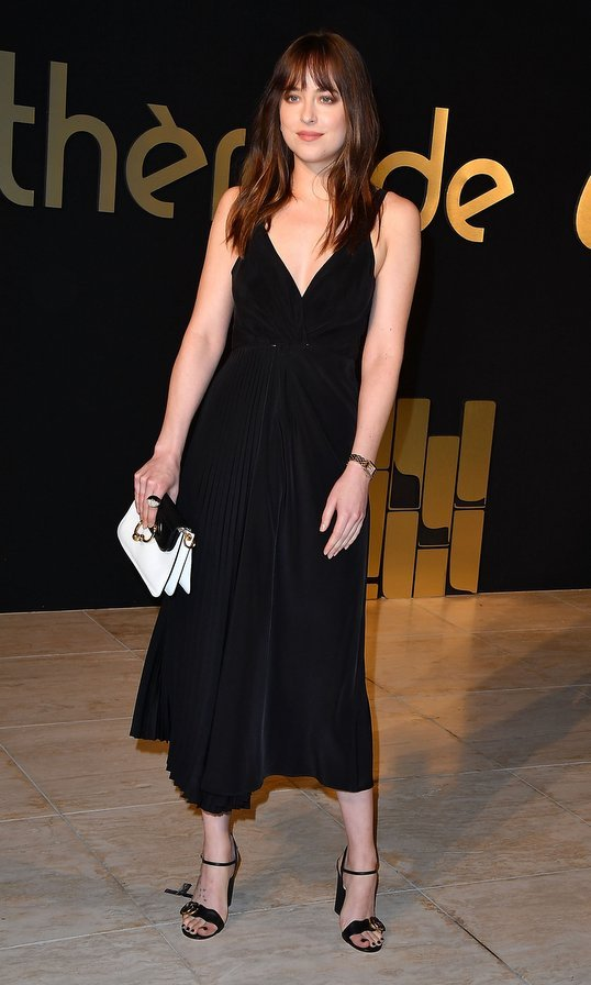 <I>50 Shades of Grey</I> star Dakota Johnson opted for an LBD by Shaina Mote at the Panthere De Cartier Party In LA at Milk Studios.