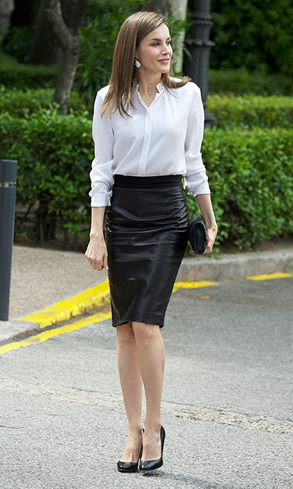 Queen Letizia of Spain opted for one of her fave wardrobe staples  – a leather pencil skirt – for the opening of an exhibition at the National Library in Madrid.