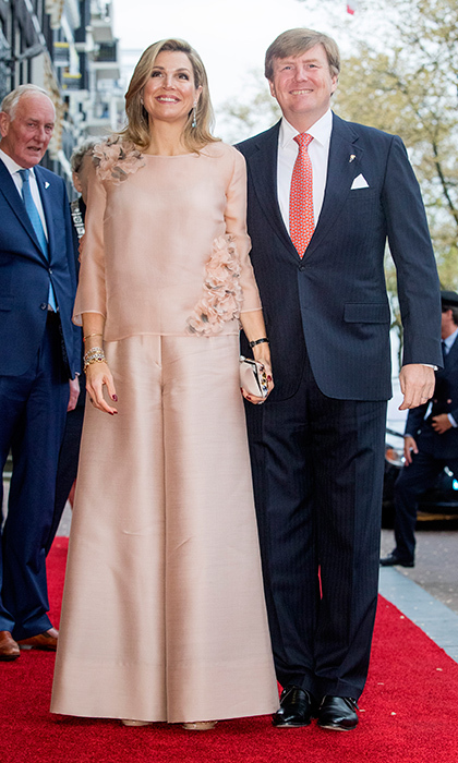 Queen Maxima of The Netherlands donned a silk flower-embroidered blouse and ultra-wide leg trousers as she joined husband King Willem-Alexander at the annual Liberation Day concert on the Amstel in Amsterdam.