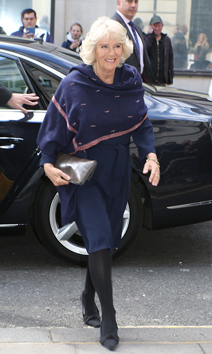 Camilla, Duchess of Cornwall accessorized with a pink and navy scarf for the cool weather as she arrived at BBC Radio 2 Studios in London, England. 