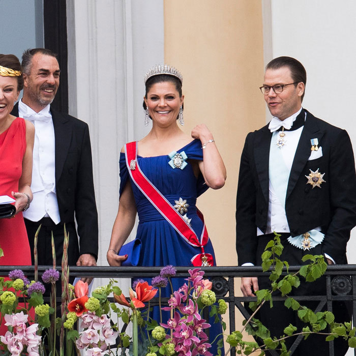 Crown Princess Victoria and her husband Prince Daniel of Sweden shared a laugh on the Palace balcony.