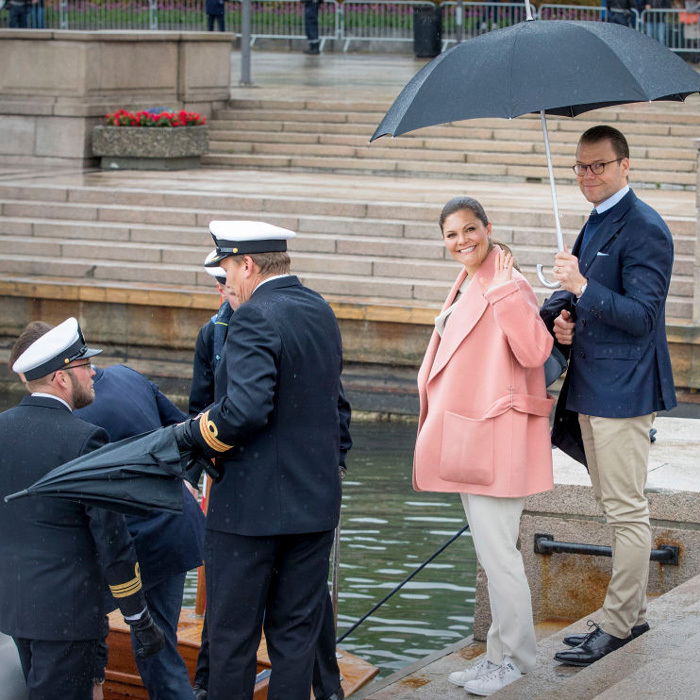 Crown Princess Victoria had the right idea with her attire, a warm pink coat and sneakers as she boarded the tender with husband Prince Daniel.