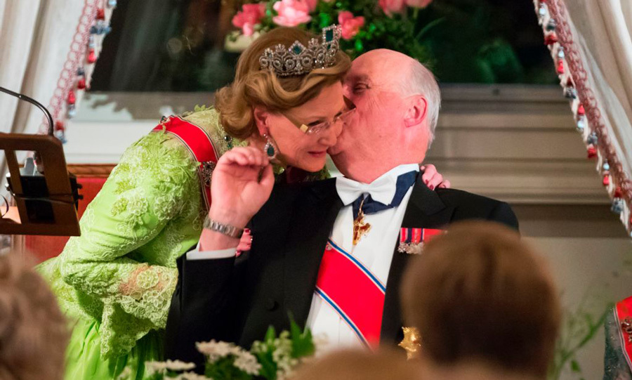 "Between mingling with guests and taking the microphone, King Harald stole a kiss with his wife of 49 years. The Crown Prince and his sister, Princess Märtha Louise also delivered remarks at the dinner telling their parents, ""We are very fond of you.""