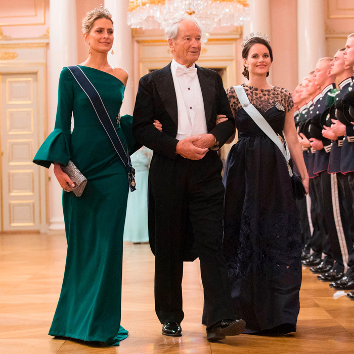 Princess Sofia showed off her baby bump in an Oscar de la Renta gown that she previously wore to the 2015 Nobel Prize Banquet. The Swedish royal walked into the banquet with Princess Tatiana of Greece.