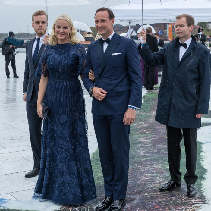 Crown Princess Mette-Marit matched her husband Crown Prince Haakon in navy for the night at the opera.
