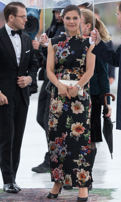 Crown Princess Victoria paired her floral-patterned dress by Acne Studio with black pumps and long tassled earrings.