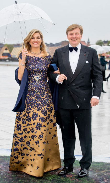 Queen Maxima rewore Dutch designer Claes Iversen's navy and gold gown to the opera in Oslo.
