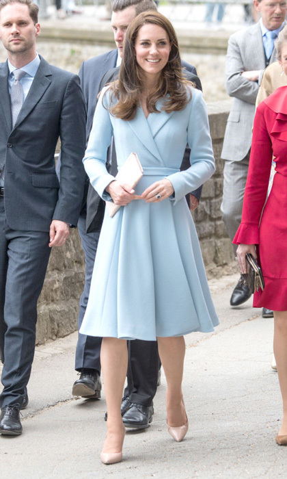 Kate Middleton wore a new Emilia Wickstead coat with long sleeves and a full, subtly pleated skirt for her day trip to Luxembourg on May 11. To keep the focus on the baby blue coat, she accessorized with nudes - patent pumps and an Etui clutch bag. 