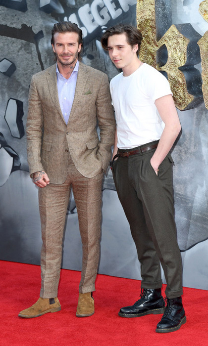 Brooklyn Beckham supported dad David at the <i>King Arthur - Legend of the Sword</i> premiere in London.