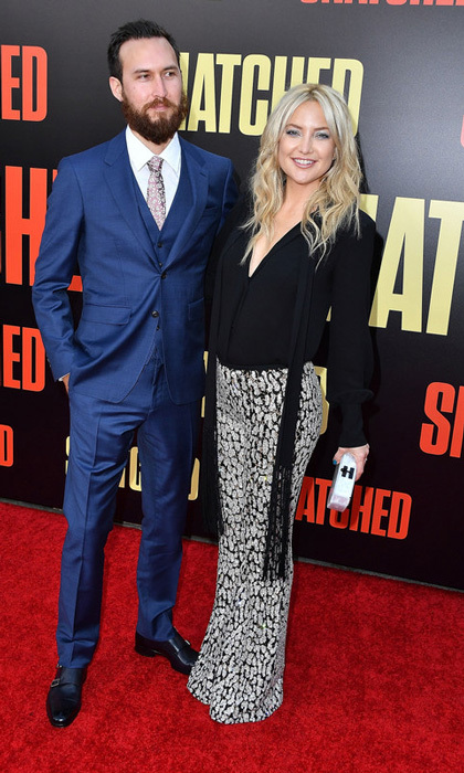 Kate Hudson in Michael Kors Collection made her red carpet debut with boyfriend Danny Fujikawa to the premiere of <i>Snatched</i> in L.A.