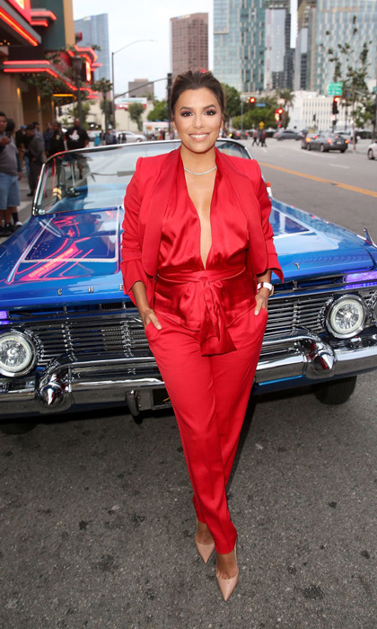 Eva Longoria took the plunge in a red satin jumpsuit for the <i>Lowriders</i> premiere at L.A. Live.