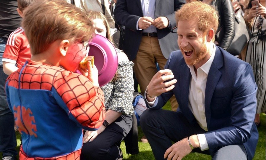 The royal trio had a blast with the children. Seen here, Prince Harry joked around with a little Spider-Man, who clearly enjoyed the event's face painting.