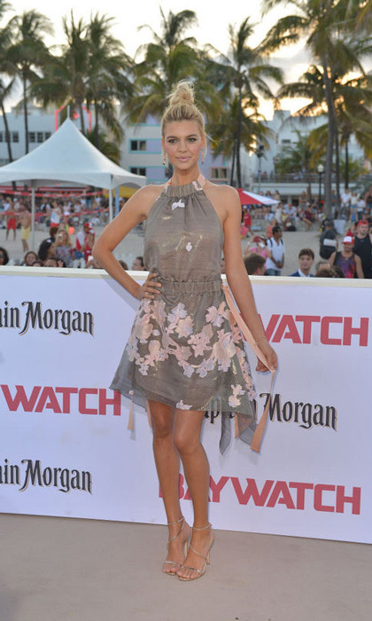 Kelly Rohrbach wore a Fendi dress, Alexander White shoes, Graziela earrings and ring, EF Collection bracelet and Jimmy Choo clutch for her big movie debut in <i>Baywatch</i> in Miami.