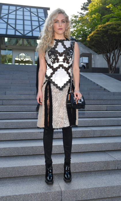 Riley Keough posed on the steps of the Miho Museum ahead of the Louis Vuitton Resort 2018 show in Koka, Japan.