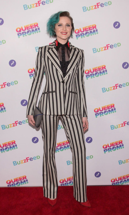 Evan Rachel Wood accessorized her striped suit with a Tyler Ellis clutch and red pumps to Buzzfeed's first Inaugural Queer Prom For LGBT Youth Los Angeles at Siren Studios.
