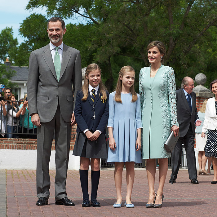 King Felipe VI and Queen Letizia of Spain were proud – and color coordinated! – parents at 10-year-old daughter Princess Sofia's First Communion at the Asuncion de Nuestra Senora Church on May 17. While Sofia is usually dressed just like 11-year-old sister Princess Leonor, who wore a pleated blue dress and Pretty Ballerina shoes, in line with tradition she instead donned her school uniform for her special day.