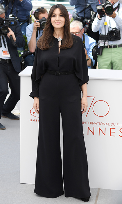 Italian star and Mistress of Ceremonies Monica Bellucci kept it simple and chic in wide-legged trousers at a photocall at the Palais des Festivals in Cannes, France. 