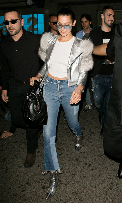 Bella Hadid made a glam exit in patchwork jeans and a silver fur-trimmed motorcycle jacket at Nice airport as she got set for the film festival in Cannes, France. 