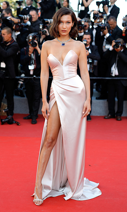 A diamond and sapphire necklace set off Bella Hadid's sexy sweetheart gown on the opening night red carpet at Cannes.