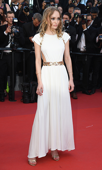 Lily-Rose Depp exuded Greek goddess glam in Chanel Resort 2018 at the premiere of <I>Ismael's Ghosts (Les Fantomes d'Ismael)</I> at the Cannes Film Festival.