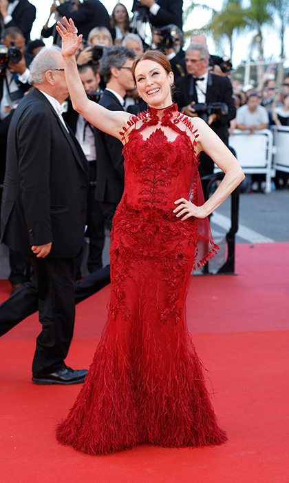 Lady in red Julianne Moore waved to fans in Givenchy Couture on the red carpet during opening night of the 70th annual Cannes Film Festival.