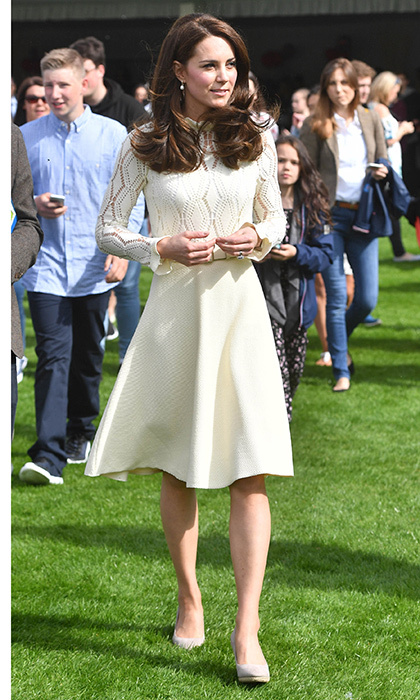 The Duchess of Cambridge recycled a knit See by Chloé dress that she wore last fall to a children's party in Canada as she helped host a tea party at Buckingham Palace. 