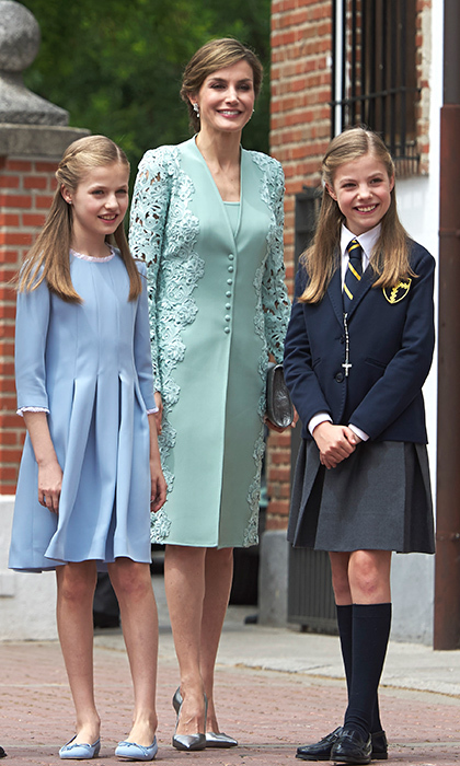 Queen Letizia of Spain reached into her wardrobe for a lace-embellished mint green summer coat and dress by Felipe Varela to attend her daughter Princess Sofia's first communion in Madrid. While Sofia wore her school uniform, big sister Princess Leonor opted for a pleated blue dress and shoes by Pretty Ballerinas.