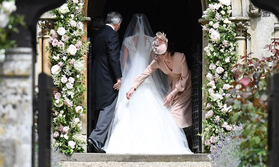 Usually the center of attention, Duchess Kate played a discreet role at Pippa's nuptials in Englefield, England in 2017, and was spotted helping adjust her little sister's train before the big walk down the aisle.