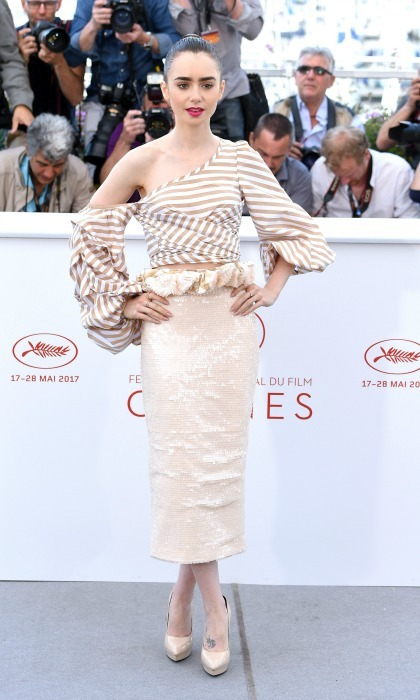 Lily Collins stunned in an off-the-shoulder look by Johanna Ortiz during the <i>Ojka</i> photocall.